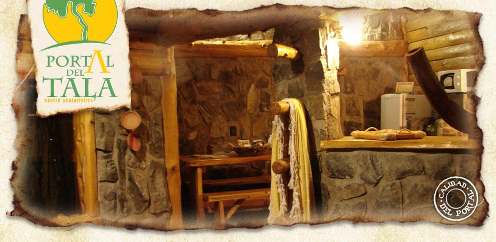 Portal del Tala interior de las cabañas de troncos